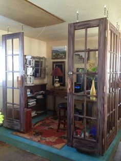 Seeing old french doors in a whole new way. Glass panel doors used as room divider to create a private space.