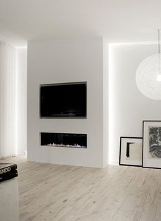 33 Stunning Modern Fireplace Design Ideas With TV Above - Modern fireplaces not just about heating the house, they are also about interior design. They are still functional and economical, but their aesthetic. Tv Above Fireplace, Linear Fireplace, Home Fireplace, Living Room With Fireplace, Fireplace Ideas, Fireplaces With Tv Above, Bioethanol Fireplace, Fireplace Lighting, Fireplace Pictures