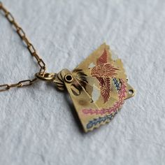 This amazingly detailed necklace is a little working fan, that can be folded out! Its made from solid brass and has the most exquisite detail engraved across the front - a scene with trees and birds flying across the sky!  The pendants are vintage Japanese dating to the late 1940s.  The fan measures 2.5cm (just an inch) when folded out and is strung on a perfectly co-ordinating brass chain. It is available in three necklace lengths.  Please refer to my illustration as a rough guide for…