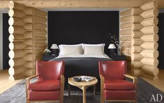An Aspen Ski Home by Atelier AM : Architectural Digest. The bed wall in the master bedroom is sheathed in cashmere, the armchairs are by Jean Royère, and the teak table is a Jeanneret-and-Perriand design. Architectural Digest, Bedroom Red, Master Bedroom, Lodge Bedroom, Master Suite, Aspen House, Colorado Homes, Bed Wall, Log Homes