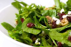 A salad with peppery arugula, salty walnuts, creamy goat cheese and sweet cranberries tossed in a sweet cranberry vinaigrette.