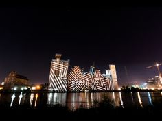 A light installation at the Dockville Festival illuminates the storehouse on the other side of the river. The end of a beautiful day with music, food, friends and fun. 3d Projection Mapping, Light Installation, Deco, Urban Art, Beautiful Day, Signage, Germany, Digital, Building