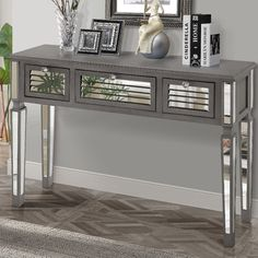 Constructed of sturdy wood and MDF with an exquisite antique silver grey finish, this Console Table will provide a room the ultimate upscale look. Each drawer has an arrangement of mirrored panels cre Decor, Furniture, Mirrored Console Table, Decor Interior Design, Sofa End Tables, Table, Home Decor, Console Table, House Of Hampton