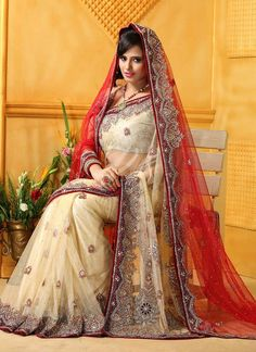 Spread the aura of freshness with this splendid cream and red net bridal saree. This attire is embellish with trendy patch border work and resham embroidery. Comes with matching blouse fabric....