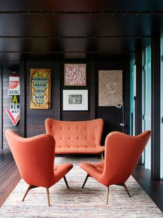 Toby Scott brightens a dark room with bright orange chairs and other pops of color