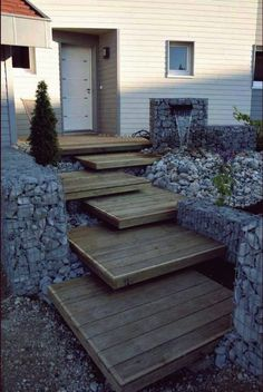 Like the stairs but could use more plants. 23 Attractive and Practical Gabion Ideas To Enhance Outdoor Space Landscape Architecture, Landscape Design, Path Design, Landscape Stairs, Design Ideas, Design Design, Gabion Wall, Gabion Fence, Outdoor Steps