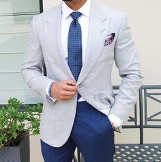 Go for a grey sport coat and navy suit pants to ooze class and sophistication.   Shop this look on Lookastic: https://lookastic.com/men/looks/blazer-dress-shirt-dress-pants/21368   — White Dress Shirt  — Navy Polka Dot Tie  — Purple Print Pocket Square  — Grey Blazer  — Navy Dress Pants