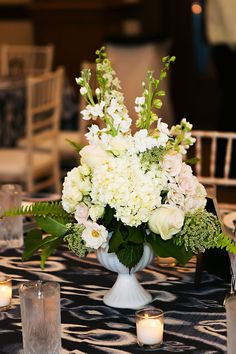 White Wedding Floral Centerpiece with Hydrangeas, Pink Roses and Greenery and Navy Blue Linens | Over the Top Linen Rentals