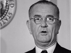 President Lyndon Johnson proclaims a day of mourning for deceased President John F. Kennedy shortly after being sworn in.