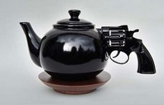 """""""Lets Talk It Over"""" Pistol-Handled Teapot.  I want this teapot so bad!"""