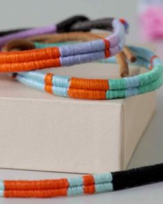 Take a trip down memory lane with this grown-up take on a cherished childhood craft: friendship bracelets! Colorful embroidery floss and a few intricate but easy-to-replicate patterns instantly upgrade the classic, not to mention symbolic, accessory.
