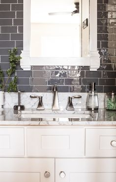 Installing tile can be tedious. Learn how easy it is to install peel and stick backsplash tiles for an affordable bathroom remodel. Stick On Tiles, Stick Tile Backsplash, Peel And Stick Tile, Backsplash With Dark Cabinets, Backsplash Ideas, Rustic Backsplash, Hexagon Backsplash, Travertine Backsplash, Beadboard Backsplash