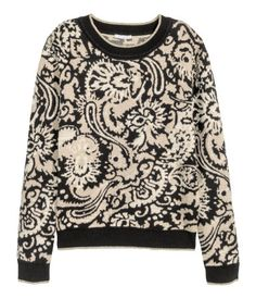 Jacquard-knit sweater in a cotton blend with mulberry silk content and glittery threads. Ribbing at neckline, cuffs, and hem. Long sleeves.