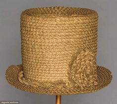 """Augusta Auctions LADY'S CHIP STRAW RIDING HAT, AMERICAN, 1810-1820 Braided chip straw (shaved wood) tall crown hat w/ narrow brim decorated w/ quilled chip blossom & entwined chip ribbon, linen interior sweat band, (4"""" unstitched area where top of hat joins sides) excellent."""