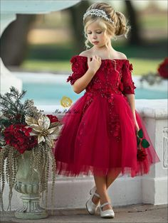 She will be the talk of this year's family holiday card. This gorgeous dark reddress has a half-sleeve off the shoulder silhouette. Its alsocovered with flowerappliques and the flared skirt is perfect for twirling in.She is guaranteed to look like perfection. Style it with dressy shoes and gold hair accessories. Fo Red Dresses For Kids, Red Flower Girl Dresses, Dark Red Dresses, Red Wedding Dresses, Little Girl Dresses, Cheap Dresses, Girls Dresses, Chiffon Dresses, Pageant Dresses