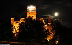 Enough to send shivers down your spine: Bran Castle looks even more eerie when illuminated at night - particularly with a full moon rising behind