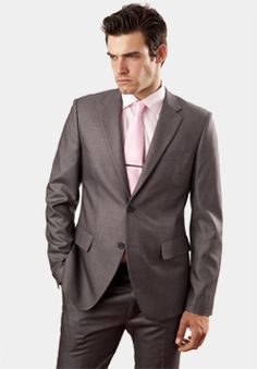 groomsmen are wearing gray suits with pink ties