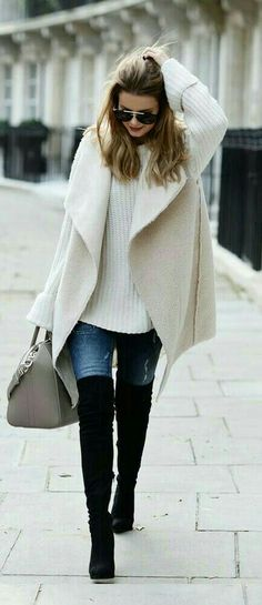 Love this chic oversized Fall sweater. Paired with over the knee boots to stay warm and cozy this Fall or Winter.