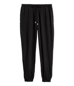 Check this out! Viscose weave trousers in a relaxed fit with an elasticated drawstring waist and pockets in the side seams. Slightly lower crotch with tapered legs and elasticated hems. - Visit hm.com to see more.