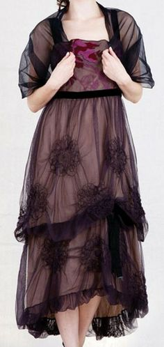 same dress but with the co-ordinationg tulle shrug (to show modesty and respect in the Cathedral.) www.nataya.com