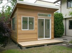 This 8x12 Studio has a 9' front wall in order to accommodate the transom window over the door and a 4' wide cedar deck. The interior walls are drywall.