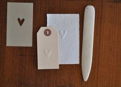 simple embossing: cut the shape you want out of thick cardstock with an exacto knife, place the paper you want to emboss over the cardstock with a hole in it, and use a bone folder or the tip of large knitting needles or of a small crochet hook to rub the paper into the hole in the cardstock.  For better instructions, go to the blog.