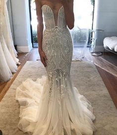 A Strapless haute couture bridal gown from DARIUS CUSTOMS can be made like this with any changes you need. We make #replicas of couture #weddingdress designs for #brides on a budget. We can recreate any dress from a picture for all types of #weddings. So if what you want is WAY over your budget we can help!