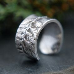 Fine silver ring molded from precious metal clay with a real fern.