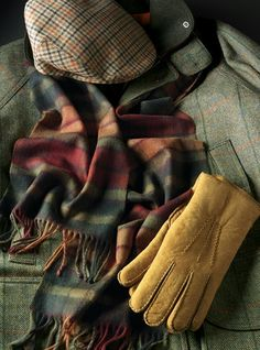 Autumn Buchanan Cashmere Scarf shown with Garforth Cap in Tan, Navy, Red, and Orange Check and Shearling Gloves in Autumn Leaf