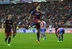 Barcelona's Uruguayan forward Luis Suarez (C) celebrates after scoring a goal during the Spanish league football match Real Sporting de Gijon vs FC Barcelona at El Molinon stadium in Gijon on February 17, 2016