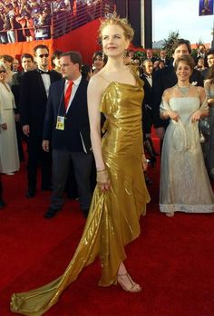 Nicole Kidman in a custom gold lamé gown with asymmetrical shoulders and hem. 2000 Academy Awards.