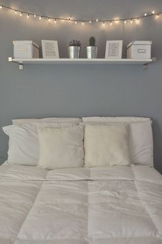 Calming... Light blue wall? Shelf above the bed seems so practical but is a little scary for me.: