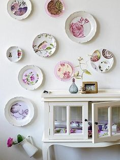 This great arrangement of vintage plates on a wall is by Kim Timmerman. Not only that but Timmerman has used cut outs from WALLPAPER and GIFT WRAP to create new plates from old ones. Hanging Plates, Plates On Wall, Plate Wall, Plate Display, Display Wall, Vintage Plates, Vintage Pyrex, Home Furnishings, Home Accessories
