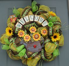 """""""Like"""" Everwreath on Facebook for sneak peeks and promos! https://www.facebook.com/everwreath Wreath creation by EverWreath  This Welcome Sunflower wreath will look great on your door this Spring and Summer! It is very bright and colorful and is very full! It had lady bugs and an adorable Owl peeking out of the top. This wreath is made with the Trick or Treat deco mesh purchased from https://www.trendytree.com"""