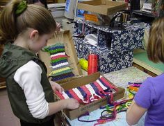 """Weaving on a cardboard box - """"Fiber artists become enchanted with color, texture & pattern. Yarns are arranged in palettes of wonderful colors & the artist is invited to choose those that connect to individual aims. Students enjoy making functional objects, often creating items for favorite toys or gifts for family members. Those who have difficulties with drawing or other two-dimensional work often excel when using yarn & cloth."""" Douglas & Jaquith, 2009 -Teaching for Artistic Behavior (TAB)…"""