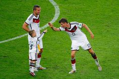 Thomas Mueller Photos Photos - Thomas Mueller of Germany (R) celebrates defeating Argentina 1-0 in extra time with Lukas Podolski and his son Louis Podolski during the 2014 FIFA World Cup Brazil Final match between Germany and Argentina at Maracana on July 13, 2014 in Rio de Janeiro, Brazil. - Germany v Argentina