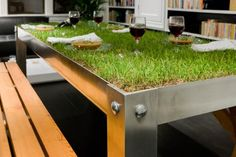 "Grass Tabletop for Indoor Picnics.  Would also be cool on a patio or where you can't have grass.  ""Unveiled by Haiko Cornelissen Architecten, the picNYC table brings the rural experience of picnicking into the residence. Coming with life grass table top, the picNYC table also features folded lightweight aluminum table top and legs form a stiff framework for the grass, soil and stones (needed for drainage)."""