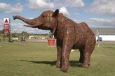 Elephant sculpture by Ken Nyberg made entirely from used lawn mower blades. www.nybergsculptures.com