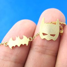 Batman themed necklace featuring a bat logo and the Batman mask in gold! Great for fans of Batman! The batman logo charm measures cm wide and the necklace measures 16 inches long. --- Handling time: - Please allow two to three business days for u Batman Mask, I Am Batman, Batman Logo, Batman Stuff, Lego Batman, Batman Wedding Rings, Harley Quinn, Nananana Batman, Batman Outfits