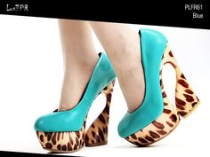 Leopard print with combo color in contrast and unique high-heel. Loving it.