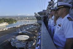PEARL HARBOR (Dec. 3, 2013) Sailors render honors as the aircraft carrier USS Nimitz (CVN 68) enters Pearl Harbor. Nimitz is in Pearl Harbor for a scheduled port visit during their transit home after an eight-month deployment to the U.S. 5th, 6th, and 7th Fleet areas of responsibility. (U.S. Navy photo by Mass Communication Specialist 3rd Class Eric M. Butler/Released)