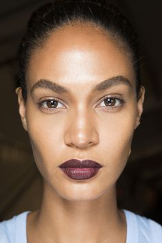 Joan Smalls full brows and plum lip at Givenchy Spring 2016