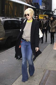 Lindsay Lohan was all smiles while out with her older brother Michael Lohan Jr and sister Ali, the family was spotted in SoHo and also stopped by Intermix to do some shopping.