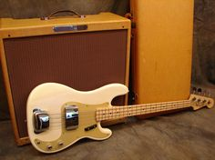 '58 Fender Precision bass w/ vintage Bassman Amp. I love the old vintage white!!!