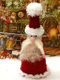 Yarn and roving Santa by gingerbread_snowflakes, via Flickr
