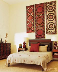 Suzani textiles used as wall art. Great way to decorate your home. Colorful and full of patterns.
