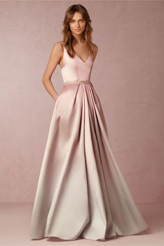 Lorraine Dress  Modern and sophisticated, this unusual dress from BHLDN is a wonderful way to bring some color to your wedding dress while making the trend all your own. This dress features an ombre effect, fading from blush into a pale grey. If you're looking for a truly unique dress that's going to make an impression, this is it.  From bhldn.com  Add Some Color: 19 Stunning Colored Wedding Dresses - EverAfterGuide