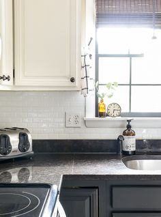 Have you ever considered adding peel & stick backsplash in your home? Are you curious how they hold up over time? Get all your questions answered and find out how ours are holding up three years later! Home Depot Backsplash, Smart Tiles Backsplash, Kitchen Backsplash Peel And Stick, Backsplash Wallpaper, Kitchen Wallpaper, Kitchen Tiles Design, Stick On Tiles, Kitchen Pictures, Updated Kitchen