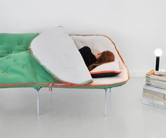 Perfect for the studio. Clients could sit on it and I could take naps on it :)  Sleeping Bag Sofa | DudeIWantThat.com