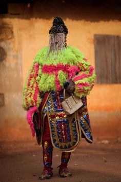 OUIDAH, BENIN - JANUARY 10: An 'Egungun' spirit stands during a Voodoo ceremony on January 10, 2012 in Ouidah, Benin. Shrouded in mystery an...